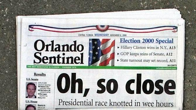 "FILE - This Nov. 8, 2000 file photo shows Orlando Sentinel election night headlines The first headline was, ""Oh, so close,"" followed by ""IT'S BUSH,"" then ""IS IT BUSH?"" and lastly ""CONTESTED."" The presidential election is still undecided while the nation waits for Florida's final vote count.  The mere mention of the 2000 election unsettles people in Palm Beach County. The county's poorly designed ""butterfly ballot"" confused thousands of voters, arguably costing Democrat Al Gore the state, and thereby the presidency.  Gore won the national popular vote by more than a half-million ballots. But George W. Bush became president after the Supreme Court decided, 5-4, to halt further Florida recounts, more than a month after Election Day. Bush carried the state by 537 votes, enough for an Electoral College edge, and the White House. (AP Photo/Peter Cosgrove, File)"