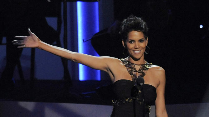 "Actress Halle Berry introduces singer Jennifer Hudson onstage at ""We Will Always Love You: a Grammy Salute to Whitney Houston,"" at Nokia Theatre on Thursday, Oct. 11, 2012, in Los Angeles. The one-hour concert tribute will air on CBS on Nov. 16. (Photo by Chris Pizzello/Invision/AP)"