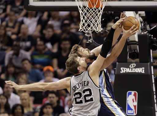 San Antonio Spurs' Tiago Splitter (22), of Brazil, blocks a shot by Memphis Grizzlies' Marc Gasol during the first half in Game 2 of the Western Conference finals NBA basketball playoff series, Tuesda