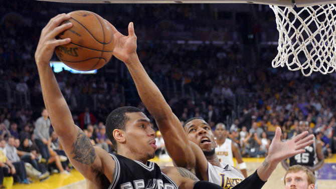San Antonio Spurs guard Danny Green (4) grabs a rebound away from Los Angeles Lakers guard Darius Morris during the first half in Game 4 of a first-round NBA basketball playoff series, Sunday, April 28, 2013, in Los Angeles. (AP Photo/Mark J. Terrill)