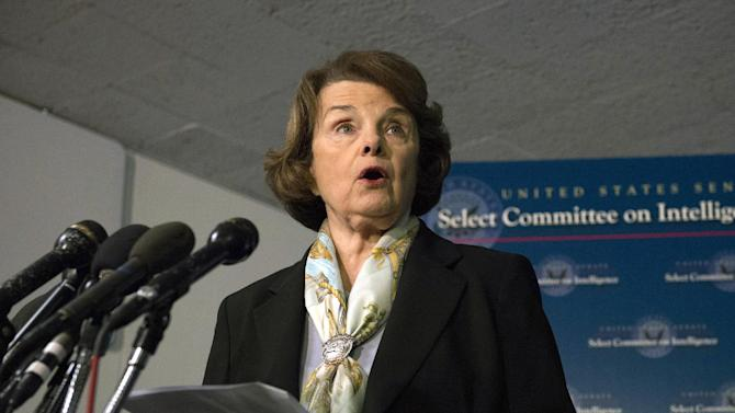 FILE - In this April 3, 2014, file photo, Senate Intelligence Committee Chair Sen. Dianne Feinstein, D-Calif. speaks after a closed-door meeting on Capitol Hill in Washington, as the panel votes to approve declassifying part of a secret report on Bush-era interrogations of terrorism suspects. The forthcoming report on the CIA's use of harsh interrogation techniques could add to the legal complications facing the long-delayed U.S. military tribunals of terrorist suspects at the Guantanamo Bay detention camp. (AP Photo/Molly Riley, File)