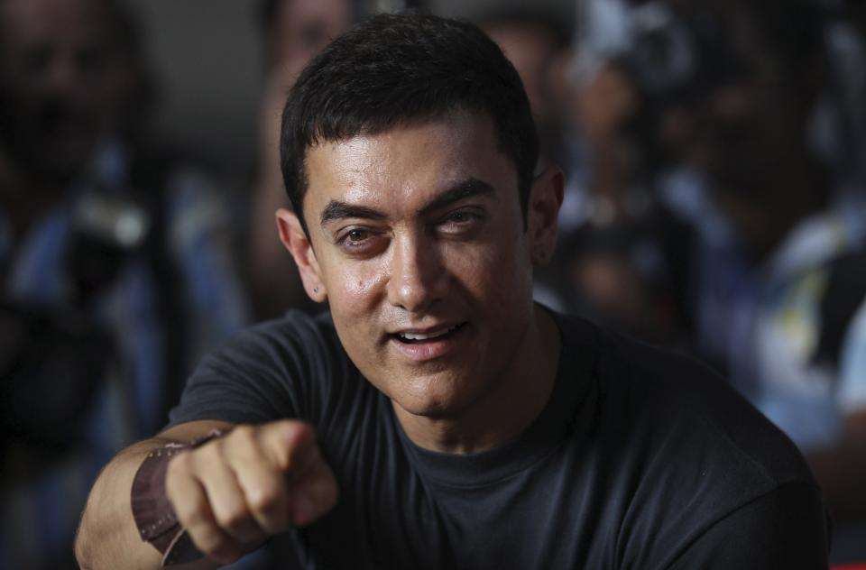 Bollywood actor Aamir Khan gestures during a media interaction on completion of his 25 years in Indian cinema, in Mumbai, India, Monday, April 29, 2013. (AP Photo/Rafiq Maqbool)