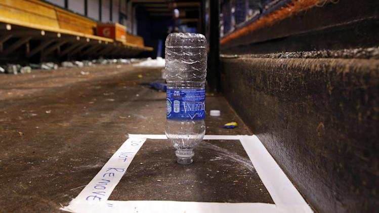 A water bottle dropped by Tampa Bay Rays first base coach George Hendrick, landing on its top, is preserved in the dugout following a win in a baseball game against the Toronto Blue Jays Saturday, July 12, 2014, in St. Petersburg, Fla. (AP Photo/Mike Carlson)