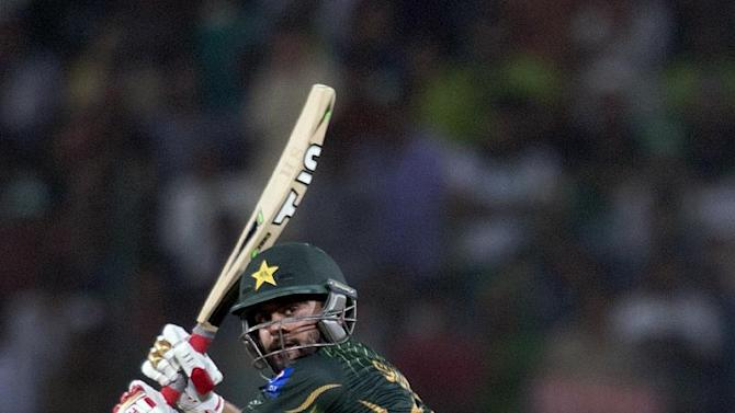 In this Friday, May 22, 2015 photo,  Pakistan's Ahmed Shehzad plays a shot during the first T-20 match against Zimbabwe at the Gaddafi stadium in Lahore, Pakistan. Pakistan opening batsmen Shehzad and Shan Masood have been recalled for the three-test series against Sri Lanka this month while offspinner Saeed Ajmal missed out, a Pakistan cricket board officials said on Wednesday, June 03, 2015. (AP Photo/B.K. Bangash)