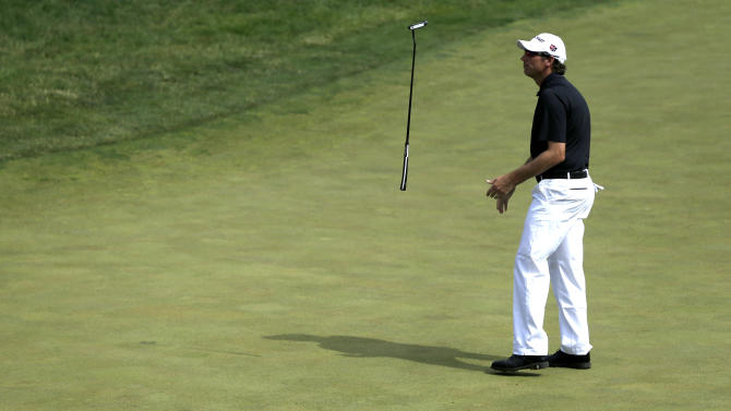 Jim Herman flips his putter after missing a putt on the 17th hole during the third round of the U.S. Open golf tournament at Merion Golf Club, Saturday, June 15, 2013, in Ardmore, Pa. (AP Photo/Julio Cortez)