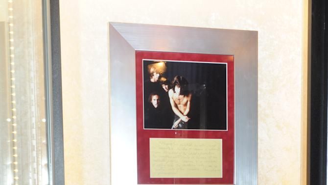 """Jim Morrison's high school yearbook is on display at Hard Rock International's traveling music memorabilia tour, """"Gone Too Soon,"""" at Hard Rock Cafe New York, Wednesday, Feb. 13, 2013. """"Gone Too Soon"""" pays tribute to music icons whose lives and career where tragically cut short and will be on tour at Hard Rock locations in the U.S. throughout 2013. (Photo by Diane Bondareff/Invision for Hard Rock International/AP Images)"""