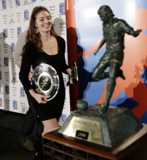 FILE - In this Nov. 11, 2008 photo, actress Bianca Kajlich, wife of US soccer player Landon Donovan the 2008 Honda Player of the Year, accepts the soccer award on his behalf, in downtown Los Angeles. Court records show soccer star Landon Donovan has filed for divorce Thursday, Dec. 23, 2010, from his actress wife in Los Angeles. (AP Photo/Ric Francis, file)