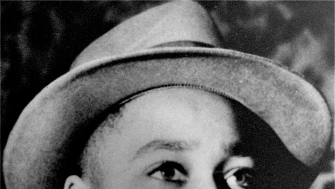 "FILE - This undated file photo shows Emmett Till, a black 14-year-old Chicago boy, who was brutally murdered near Money, Mississippi, Aug. 31, 1955, after whistling at a white woman. Epic Records is going to ""great efforts"" to take down a new Future remix leaked over the weekend with a vulgar lyric by Lil Wayne that has offended the family of Emmett Till. (AP Photo/File)"