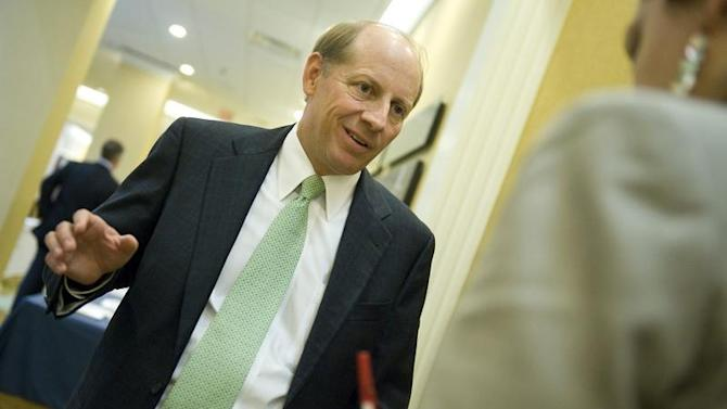 Zions Bancorp CEO Simmons talks to a reporter at the American Banker Regulatory Symposium in Washington