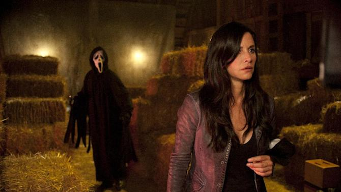 """In this publicity image released by The Weinstein Company, Courteney Cox is shown in a scene from the horror film """"Scream 4."""" The MTV network says it will produce a pilot for a TV-series adaptation of the wildly popular slasher films. The series would reinvent the horror-comedy franchise that began with the original release in 1996 and spawned three sequels, the most recent in 2011. The films' original director, Wes Craven, is in discussions to direct the one-hour pilot, MTV said.  The """"Scream"""" series is planned to debut in summer 2014.  (AP Photo/Dimension Films-The Weinstein Company, Gemma La Mana)"""
