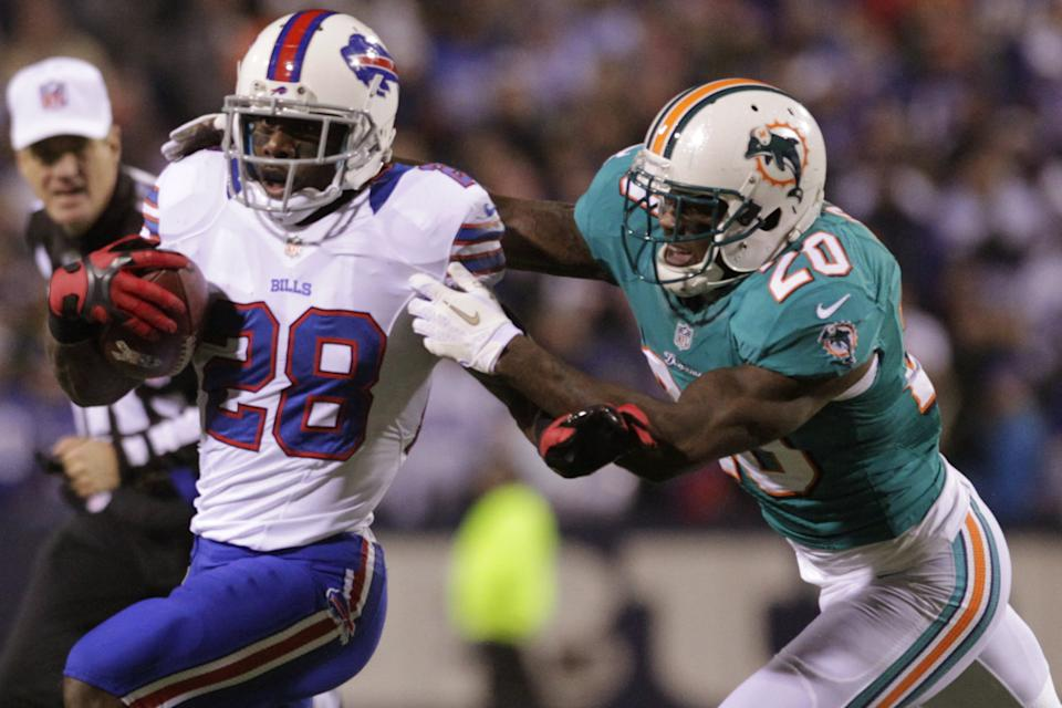 Buffalo Bills running back C.J. Spiller (28) is tackled by Miami Dolphins' Reshad Jones (20) during the first half of an NFL football game on Thursday, Nov. 15, 2012, in Orchard Park, N.Y. (AP Photo/Bill Wippert)