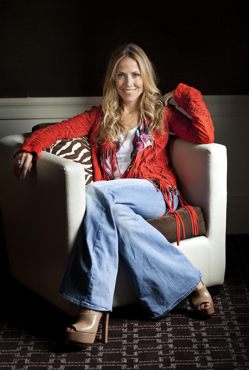 "FILE - This July 19, 2010 file photo shows singer Sheryl Crow posing for a portrait in New York. Crow's latest release, ""Feels Like Home,"" will be released on Sept. 10. (AP Photo/Victoria Will, file)"