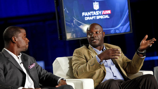 Former NFL quarterback Kordell Stewart, and former NFL player Sterling Sharpe are seen during the DirecTV NFL Fantasy Week on Thursday, Aug. 23, 2012 at the Best Buy theatre in Times Square in New York. (Photo by Brian Ach/AP Images for NFL)