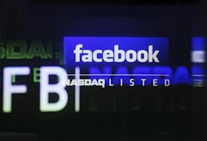 The Facebook logo is seen on a screen inside at the Nasdaq Marketsite in New York May 18, 2012. REUTERS/Shannon Stapleton/Files
