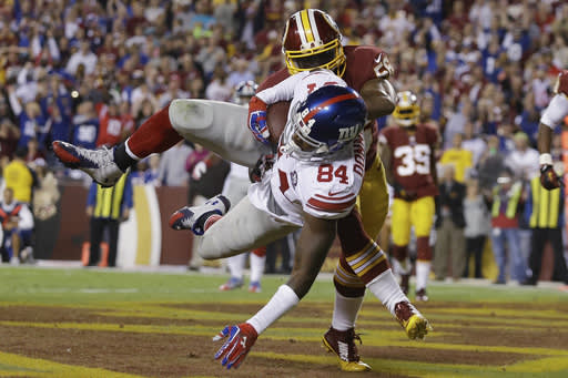 Donnell catches on as Giants rout Redskins 45-14