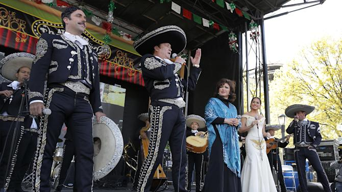 """IMAGE DISTRIBUTED FOR UNIVISION - From left, Rafael Negrete, Arturo Peniche, Angelica Maria, Danna Garcia, and Jorge Salinas, members of the hit primetime novela, """"Que Bonito Amor"""" (What a Beautiful Love), perform for an audience of more than 100,000 fans in Flushing Meadows Park to celebrate Cinco de Mayo, Sunday, May 5, 2013, in the Queens borough of New York. Univision Network treated the adoring audience with the Mariachi performance as part of the Casa Puebla New York's festivities. (John Minchillo / AP Images for Univision)"""