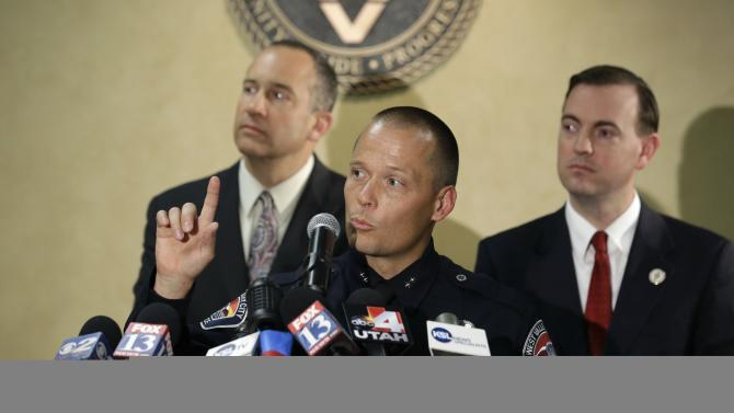 West Valley City Deputy Police Chief Mike Powell, center, makes remarks during a news conference, while West Valley City Mayor Mike Winder, right, and West Valley City Manager Wayne Pyle, left, look on Monday, May 20, 2013, in West Valley City, Utah. Citing a lack of leads, a police agency said Monday that it is closing the active investigation of the disappearance of Susan Powell, a Utah mother whose now-dead husband was a prime suspect. (AP Photo/Rick Bowmer)