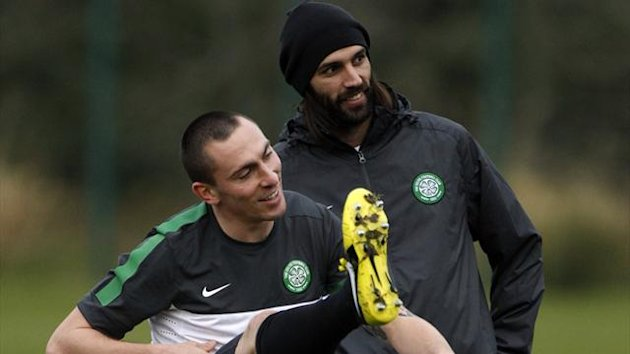 Celtic&#39;s Scott Brown (L) and Georgios Samaras laugh during a training session at their training facility in Lennoxtown  (Reuters)