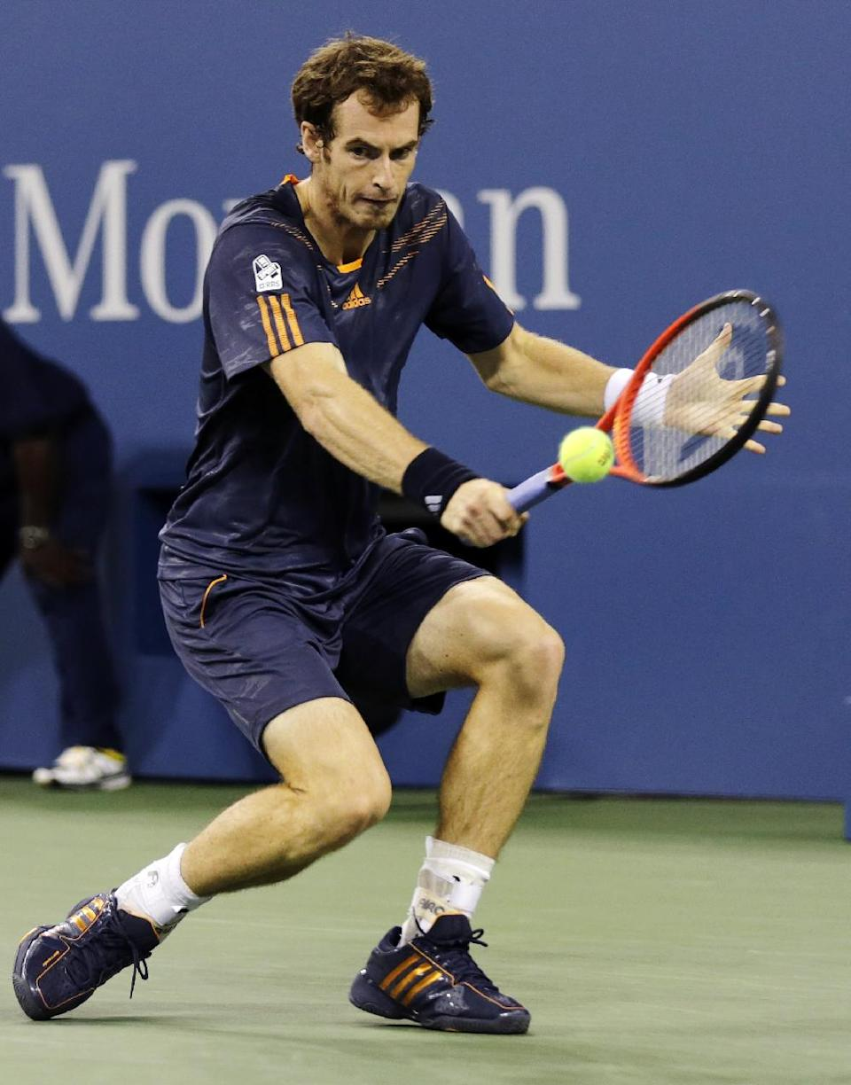 Andy Murray, of Britain, returns to Ivan Dodig, of Croatia, in the second round of play at the U.S. Open tennis tournament, Wednesday, Aug. 29, 2012, in New York. (AP Photo/Charles Krupa)