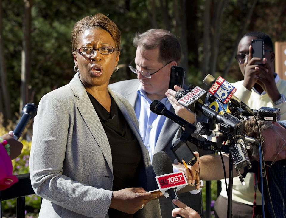 Fulton County Police spokeswoman Cpl.  Kay Lester speaks to reporters  outside the World Changers International church in College Park, Ga., after a fatal shooting inside Wednesday, Oct. 24, 2012. Police say a volunteer leading a prayer service was shot and killed by a former church employee.  (AP Photo/John Bazemore)