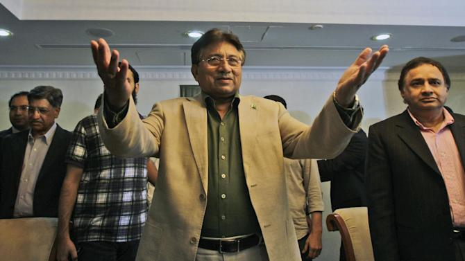 Former Pakistani President Pervez Musharraf attends a ceremony to celebrate Pakistan National Day ahead his trip to Karachi on Sunday, in Dubai, United Arab Emirates, Saturday, March 23, 2013. Musharraf says he will follow through with his plans to return to his homeland despite risks of arrest and other threats. (AP Photo/Kamran Jebreili)