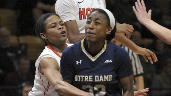 Notre Dame's Jewell Loyd (32) drives to the basket against Virginia Tech's Rachel Camp during the first half of an NCAA college basketball game Thursday, Jan. 29, 2015, in Blacksburg, Va. (AP Photo/Don Petersen)