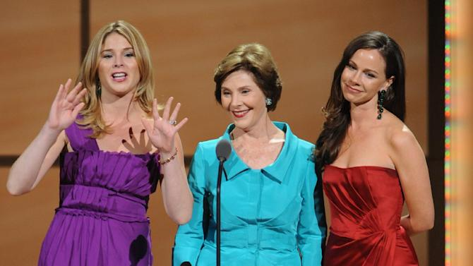 From left, Jenna Bush Hager, Barbara Bush, and Laura Bush, are seen on stage at the Glamour Magazine Honors The 21st Annual Women of the Year Awards ceremony at Carnegie Hall, Monday, Nov. 7, 2011, in New York. (AP Photo/Brad Barket)