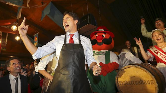 Liberal leader Trudeau counts down before tapping a keg during an Oktoberfest celebration in Kitchener