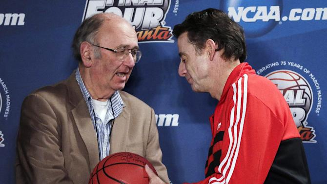 AP Basketball Writer Jim O'Connell, left, is honored by Louisville coach Rick Pitino after a news conference for the NCAA Final Four tournament, Sunday, April 7, 2013, in Atlanta. Louisville plays Michigan in the basketball championship game on Monday. Covering his 35th Final Four, AP Basketball Writer Jim O'Connell was honored by the NCAA and the Final Four coaches today. (AP Photo/Chris O'Meara)