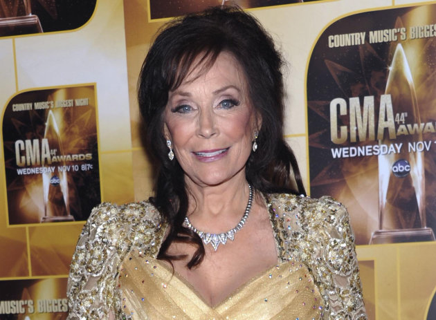 FILE - In this Nov. 10, 2010 file photo, singer Loretta Lynn poses in the press room during the 44th Annual Country Music Awards in Nashville, Tenn. Lynn celebrated 50 years of Grand Ole Opry membership Tuesday, Sept. 25, 2012 at the Opry House in Nashville. (AP Photo/Evan Agostini, File)