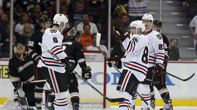 Chicago Blackhawks' Nick Leddy, left, celebrates his goal with Patrick Kane during the second period of an NHL hockey game against the Anaheim Ducks in Anaheim, Calif., Wednesday, March 20, 2013. (AP Photo/Jae C. Hong)