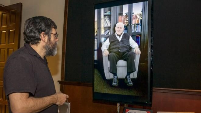 "Computer scientist David Traum, left, interacts with a Holocaust survivor using the ""Virtual Survivor Visualization."""
