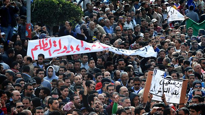 Egyptians chant slogans during a mass funeral in Port Said, Egypt, Sunday, Jan. 27, 2013. Tens of thousands of mourners poured into the streets of the restive Egyptian city of Port Said on Sunday for a funeral for most of the 37 people killed in rioting a day earlier, chanting slogans against Islamist President Mohammed Morsi. (AP Photo)