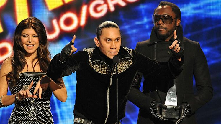 Fergie, Taboo, and will.i.am of the Black Eyed Peas onstage at the 2009 American Music Awards at Nokia Theatre L.A. Live on November 22, 2009 in Los Angeles, California.