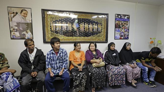 In this Thursday, Sept. 20, 2012 photo, Burmese residents wait in the lobby of the Burmese Advocacy Center in Fort Wayne, Ind. The center, which is funded by federal grants and private donations, helps refugees find jobs and homes and navigate issues from laws and customs to getting a driver's license. (AP Photo/Darron Cummings)