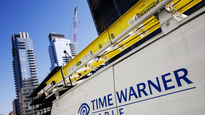 FILE - In this Feb. 2, 2009 file photo, a Time Warner Cable truck is parked in New York. Cable TV operator Charter Communications said Monday, Jan. 13, 2014, it wants to buy the much larger Time Warner Cable in a cash-and-stock deal that could be worth up to $38 billion. (AP Photo/Mark Lennihan, file)