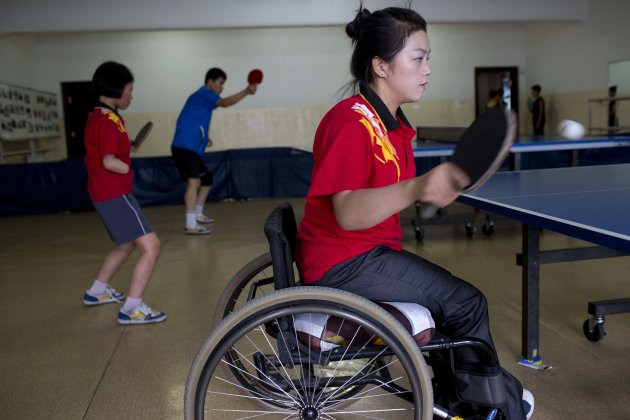 In this June 13, 2012 photo, disabled North Korean table tennis players practice at the Taedonggong Cultural Center for the Disabled in Pyongyang, North Korea. North Korea, long accused of shunting it