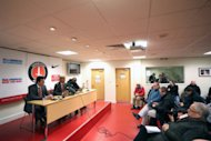 Charlton Athletic's Manager Jose Riga (centre) speaks at the post match press conference alongside Assistant Head Coach Karel Fraeye (left) and Assistant Manager Alex Dyer (right)