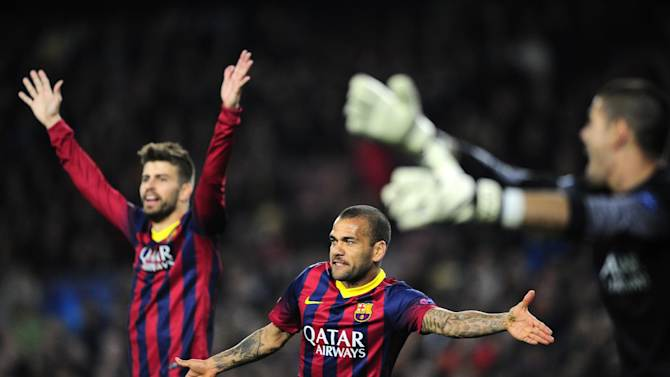 Barcelona's Gerard Pique, Daniel Alves and  goalkeeper Victor Valdes, from left to right, gesture during a Champions League, round of 16, second leg, soccer match between FC Barcelona and Manchester City at the Camp Nou Stadium in Barcelona, Spain, Wednesday March 12, 2014
