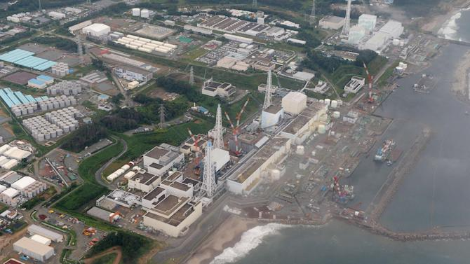 This Tuesday, Aug. 20, 2013 aerial photo shows the Fukushima Dai-ichi nuclear plant at Okuma in Fukushima prefecture, northern Japan. Deep beneath Fukushima's crippled nuclear power station a vast underground reservoir of highly contaminated water that began spilling from the plant's reactors during the 2011 earthquake and tsunami has been creeping slowly toward the sea. (AP Photo/Kyodo News) JAPAN OUT, MANDATORY CREDIT