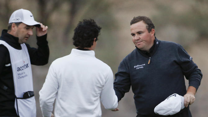 Ireland's Shane Lowry, right, shakes hands with Northern Ireland's Rory McIlroy after defeating McIlroy 1 up in the first round of the Match Play Championship golf tournament, Thursday, Feb. 21, 2013, in Marana, Ariz. (AP Photo/Ross D. Franklin)