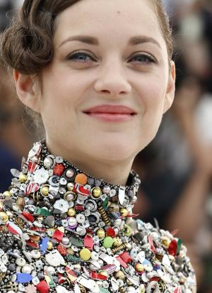 Actress Marion Cotillard poses for photographers during a photo call for Two Days, One Night (Deux jours, une nuit) at the 67th international film festival, Cannes, southern France, Tuesday, May 20, 2014. (AP Photo/Alastair Grant)