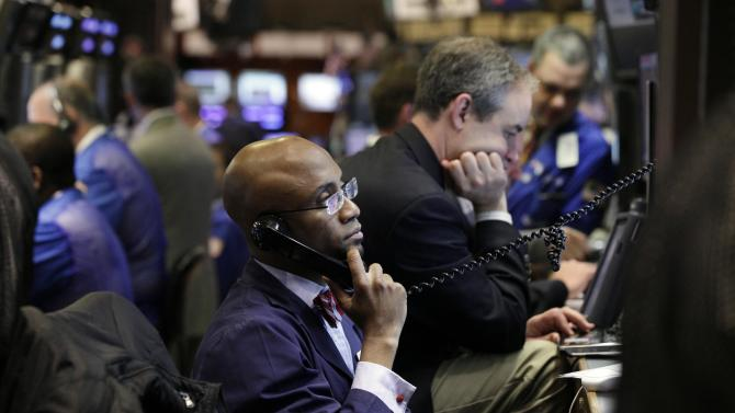 FILE - In this June 4, 2012, file photo, trader Lewis Vande Pallen, center, works on the floor of the New York Stock Exchange. US stock futures are sliding along with investor confidence in the ability of the world's economic leaders to unravel Europe's worsening debt crisis.  (AP Photo/Richard Drew, File)