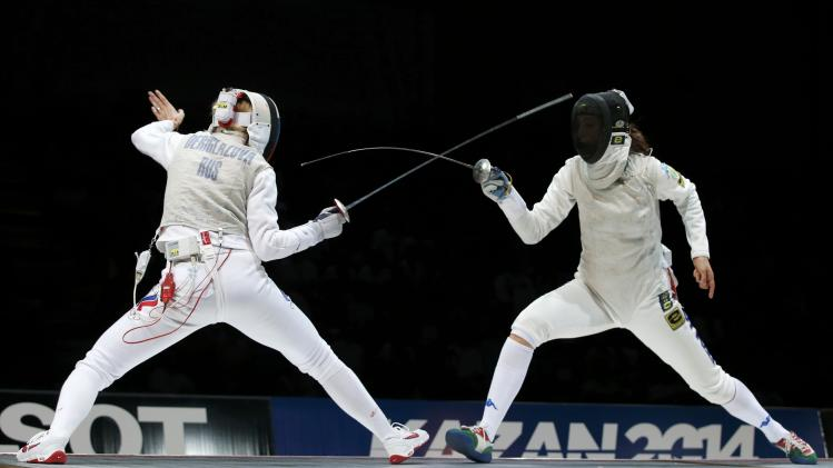 Deriglazova of Russia competes against Batini of Italy in the women's team foil final match at the World Fencing Championships in Kazan