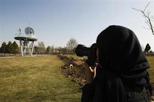 A photojournalist takes pictures at the Iranian Space Agency in Mahdasht