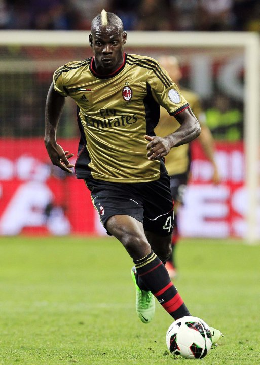 AC Milan's Balotelli controls the ball during his Italian Serie A soccer match against AS Roma in Milan