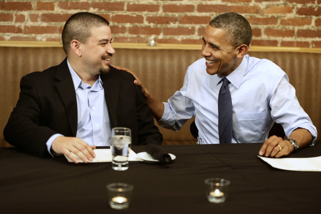 President Barack Obama meets with Mario Orosa, left, of North Canton, Ohio, and other winners of the &quot;Dinner With Barack&quot; campaign fundraising contest at Smith Commons Dining Room and Public House in Washington, on Friday, Oct. 12, 2012. (AP Photo/Jacquelyn Martin)