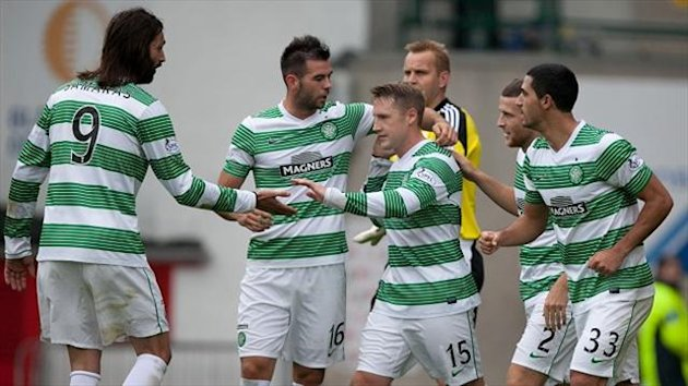 Kris Commons, centre, scored a penalty on the brink of half-time in Celtic's 2-0 victory over Aberdeen