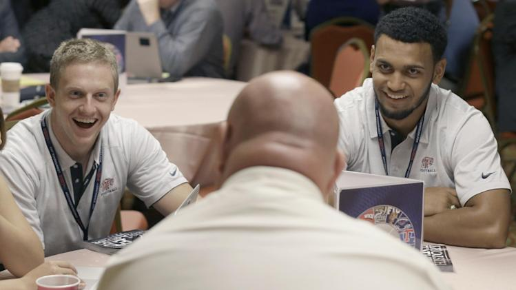 UTEP quarterback Jameill Showers, right, and defensive back Wesley Miller, left, share a laugh with head coach Sean Kugler during the NCAA college Conference USA football media day in Irving, Texas Wednesday, July 23, 2014. (AP Photo)