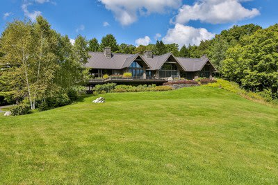 Set at an elevation of 1,400 feet, the property features 40-mile views overlooking the famed Green Mountains